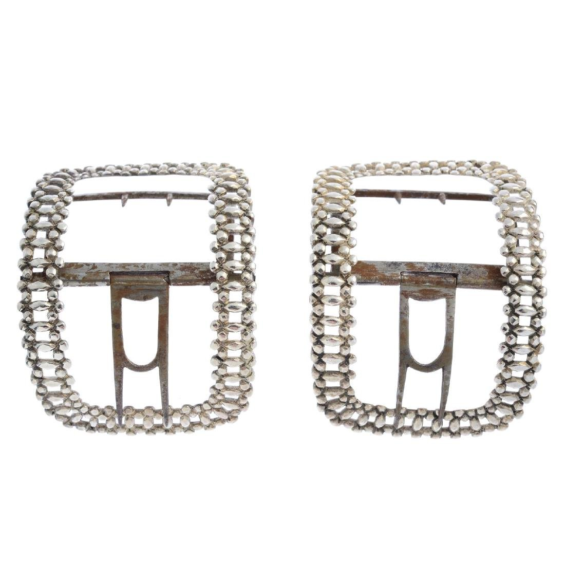 A pair of George III silver buckles. Each of curved