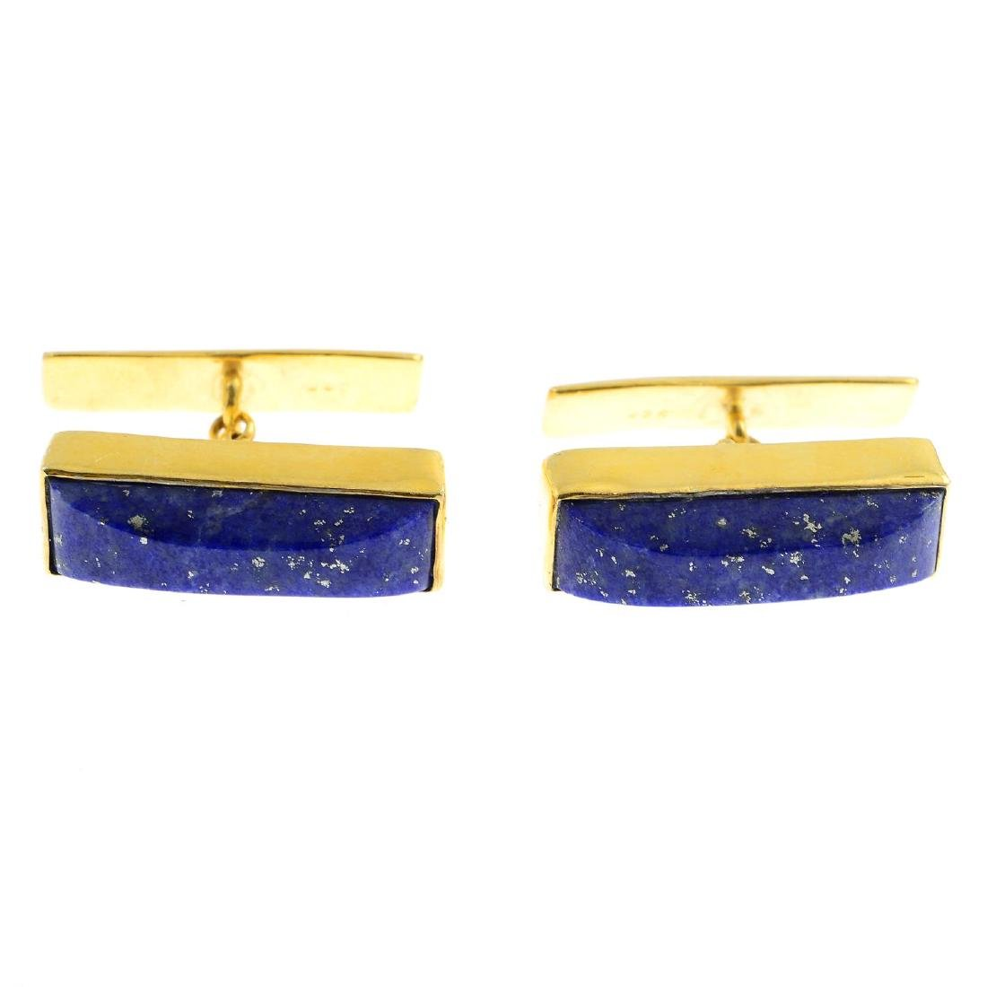 A pair of lapis lazuli cufflinks. Each designed as a