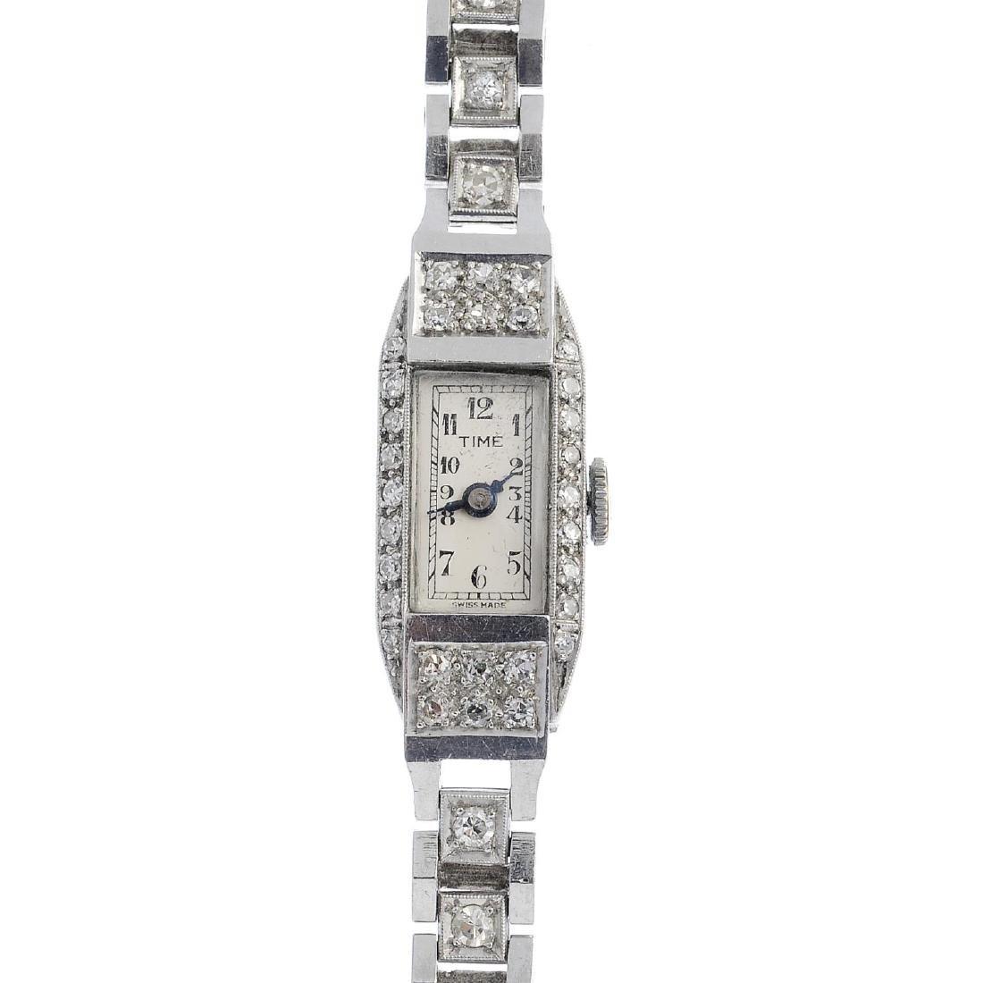 A lady's mid 20th century platinum diamond cocktail