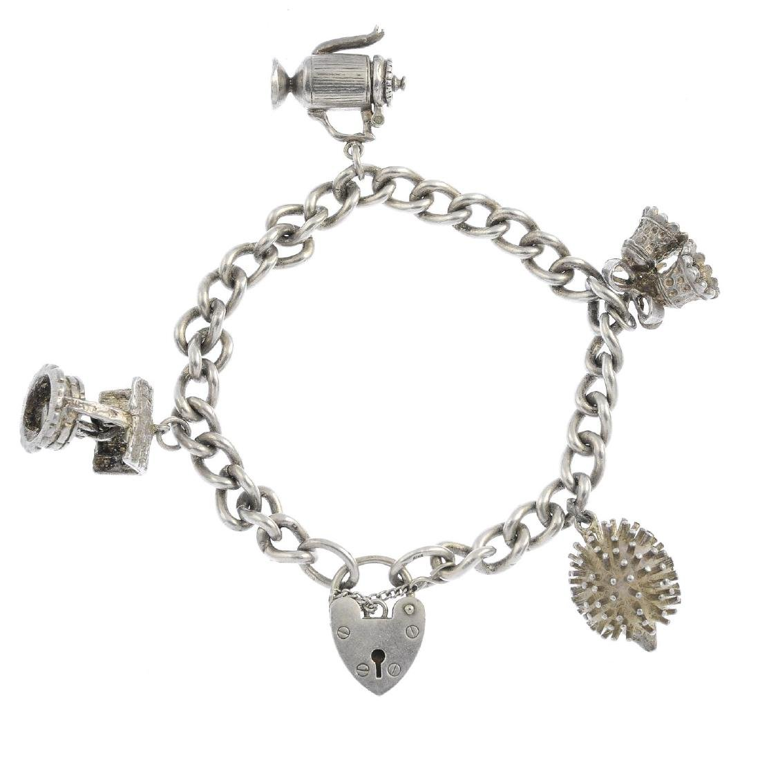 Three silver charm bracelets and charms. Each designed