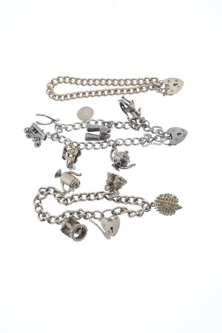 Three silver charm bracelets and charms. Each designed - 2