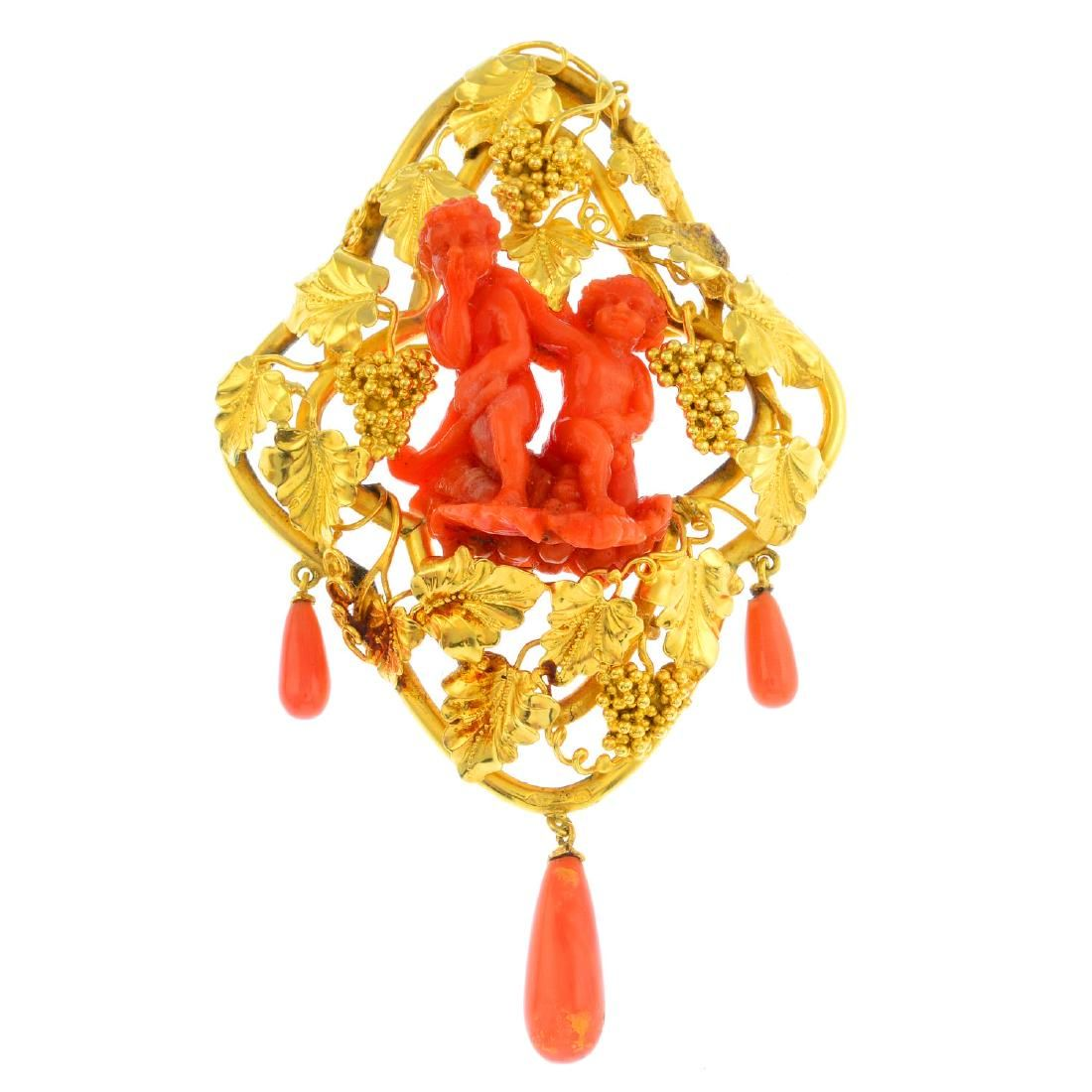 A mid Victorian gold coral brooch. The coral carved to