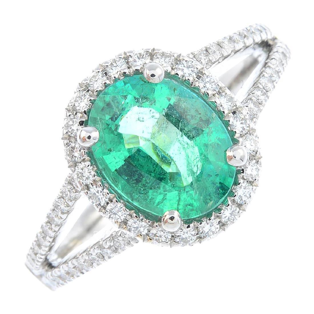 An emerald and diamond dress ring. Designed as an