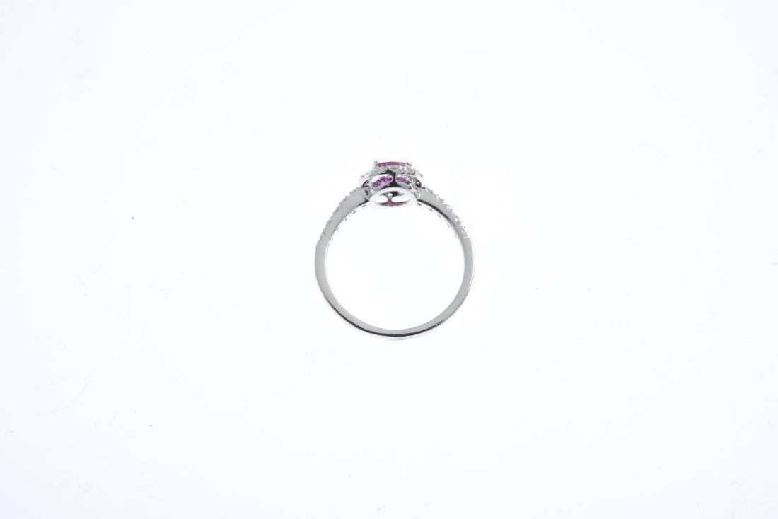 A ruby and diamond cluster ring. The oval-shape ruby, - 2