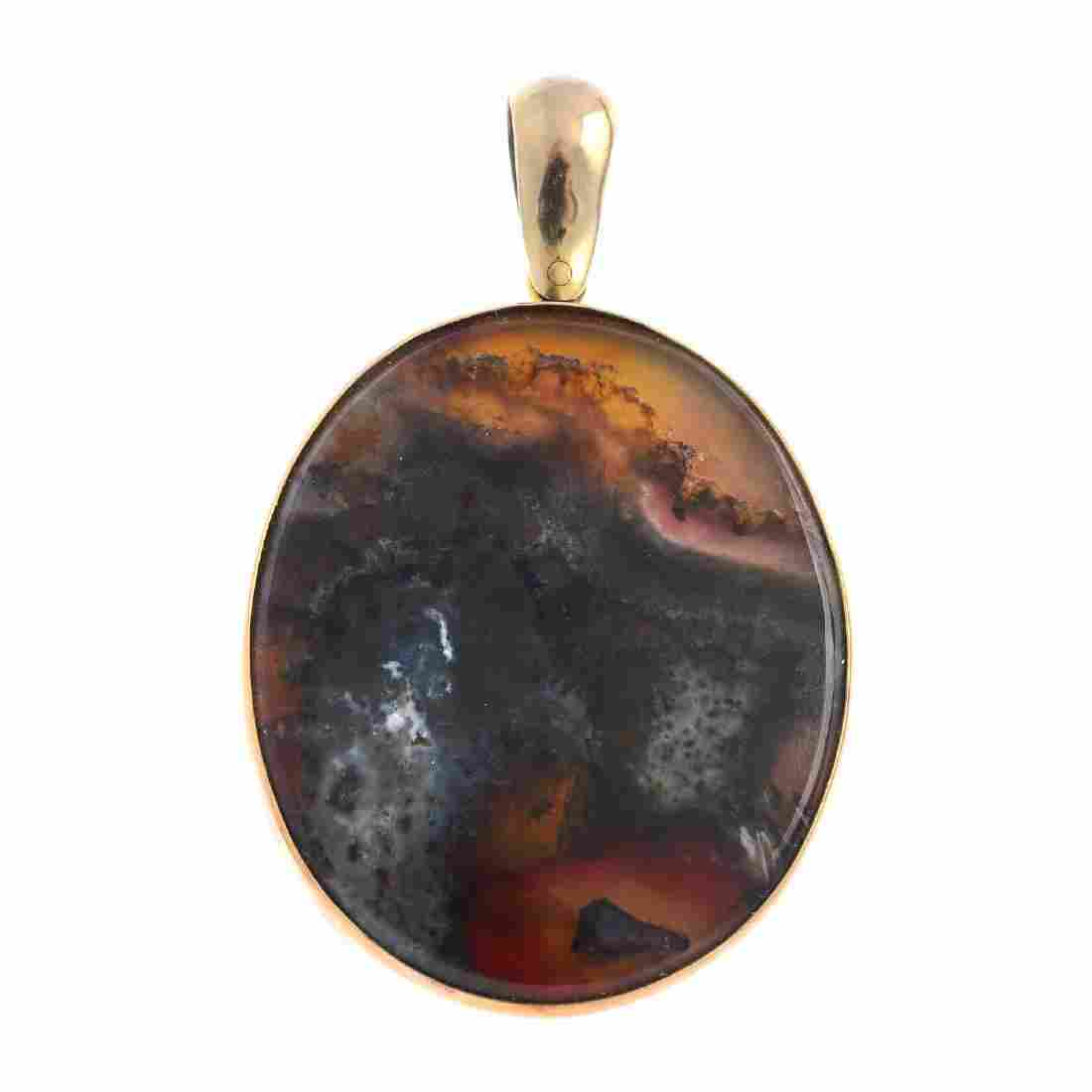 A late Victorian gold agate pendant. Of oval outline,