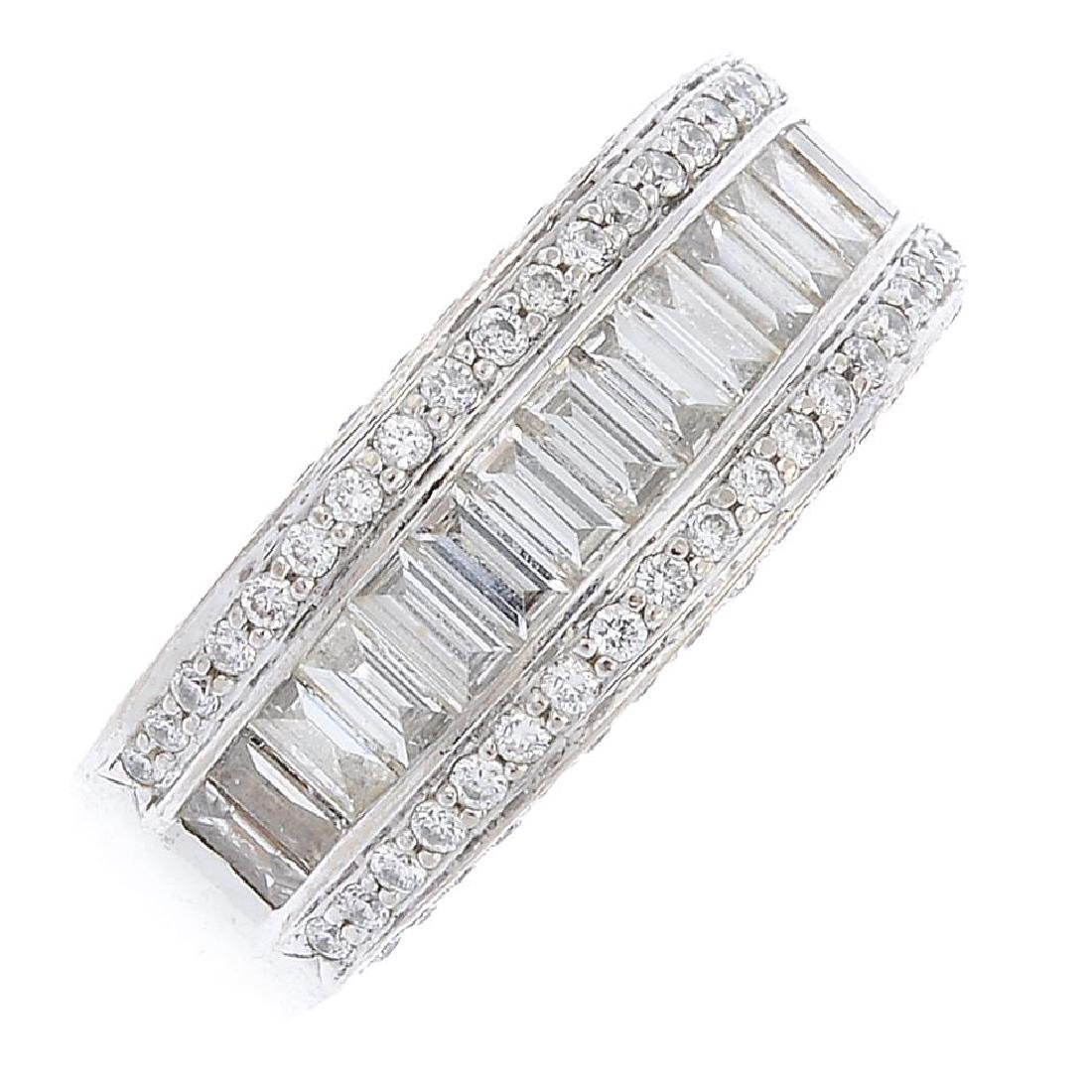 (21482) A diamond band ring. Designed as a baguette-cut
