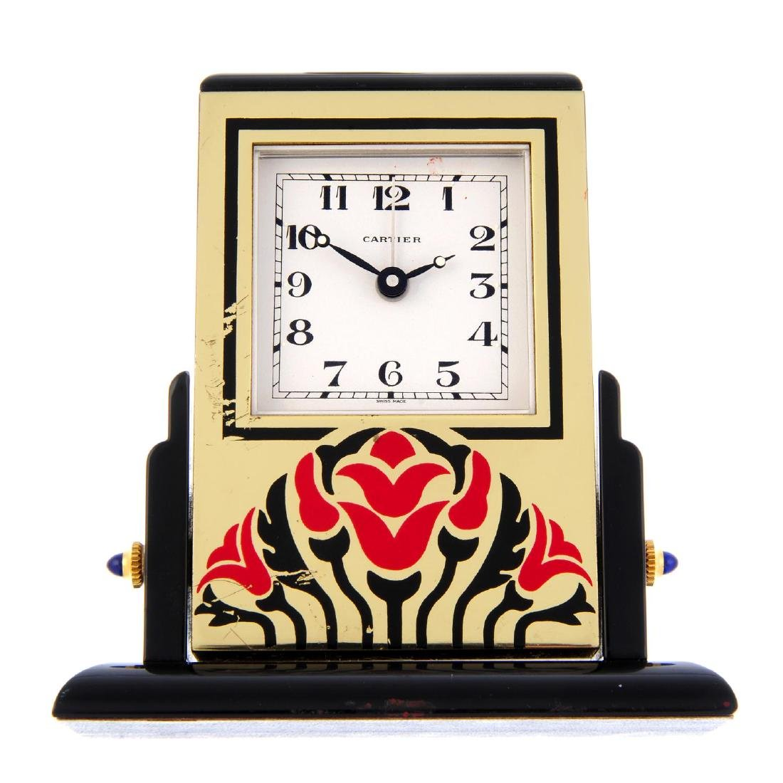 An alarm mantle clock by Cartier. Bi-material case.