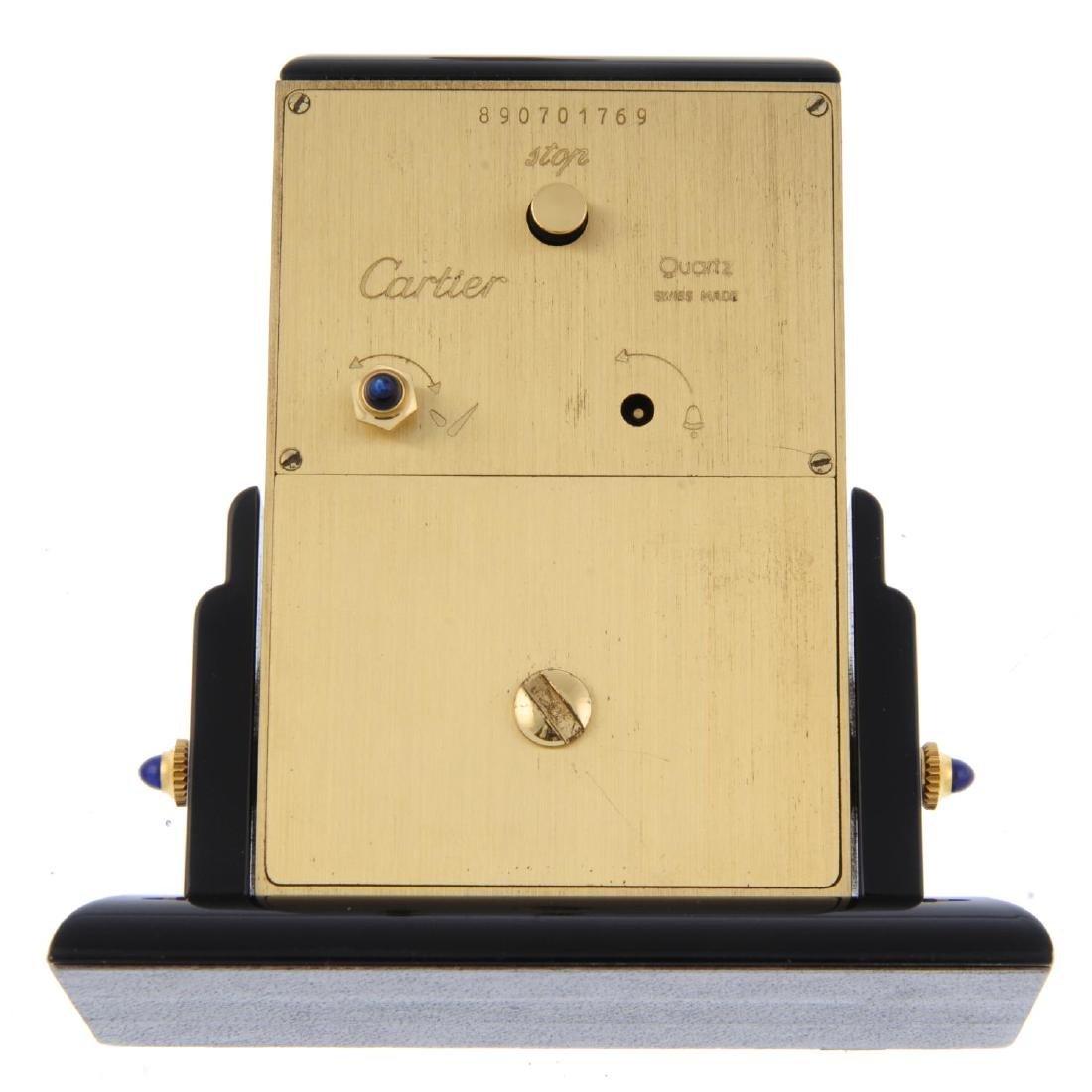 An alarm mantle clock by Cartier. Bi-material case. - 2
