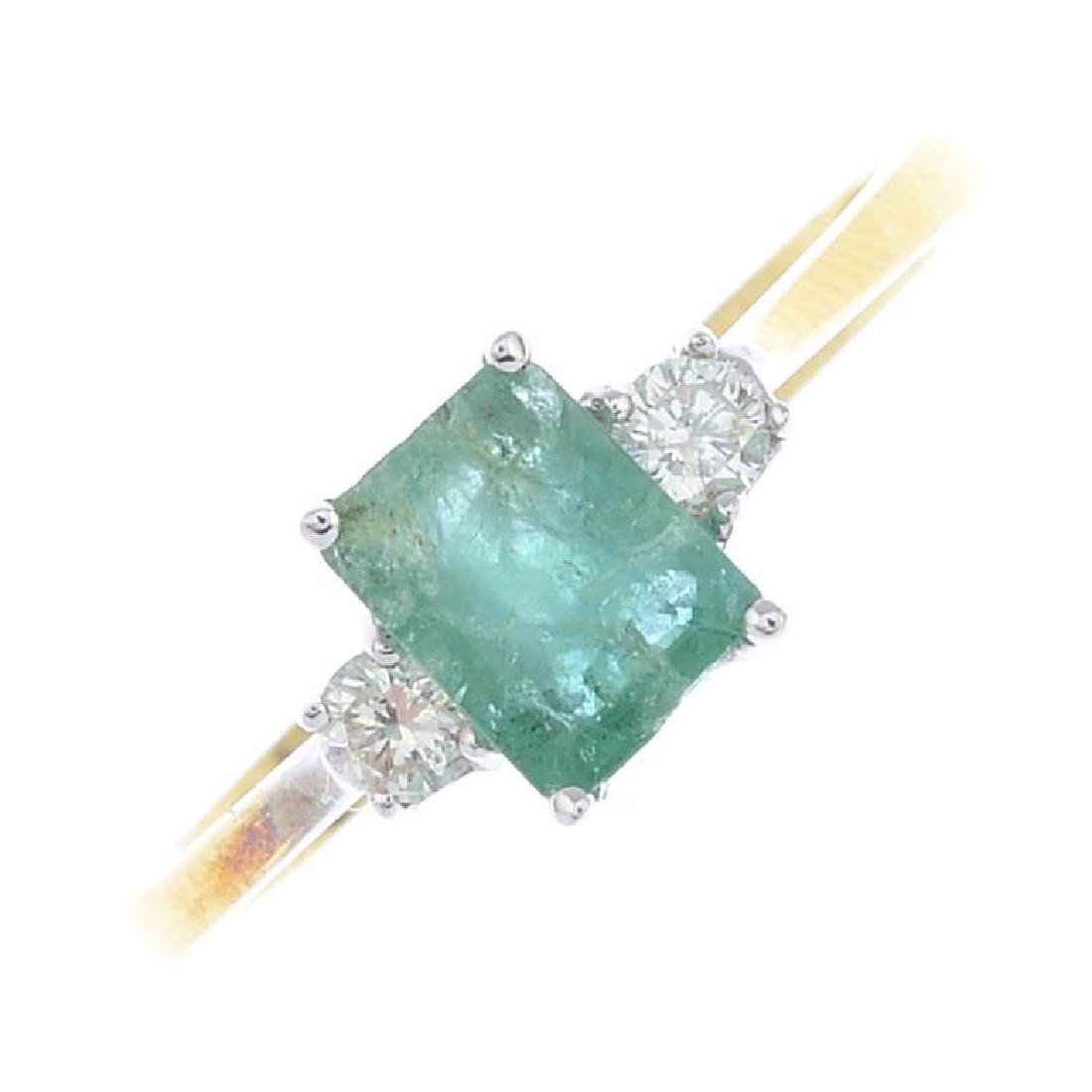 An 18ct gold emerald and diamond three-stone ring. The