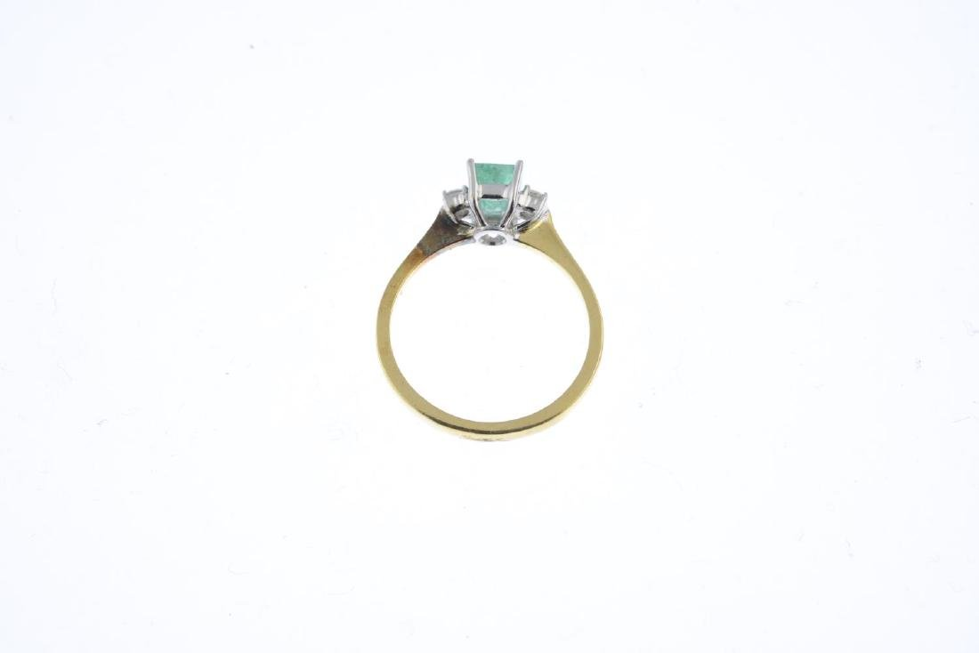 An 18ct gold emerald and diamond three-stone ring. The - 2