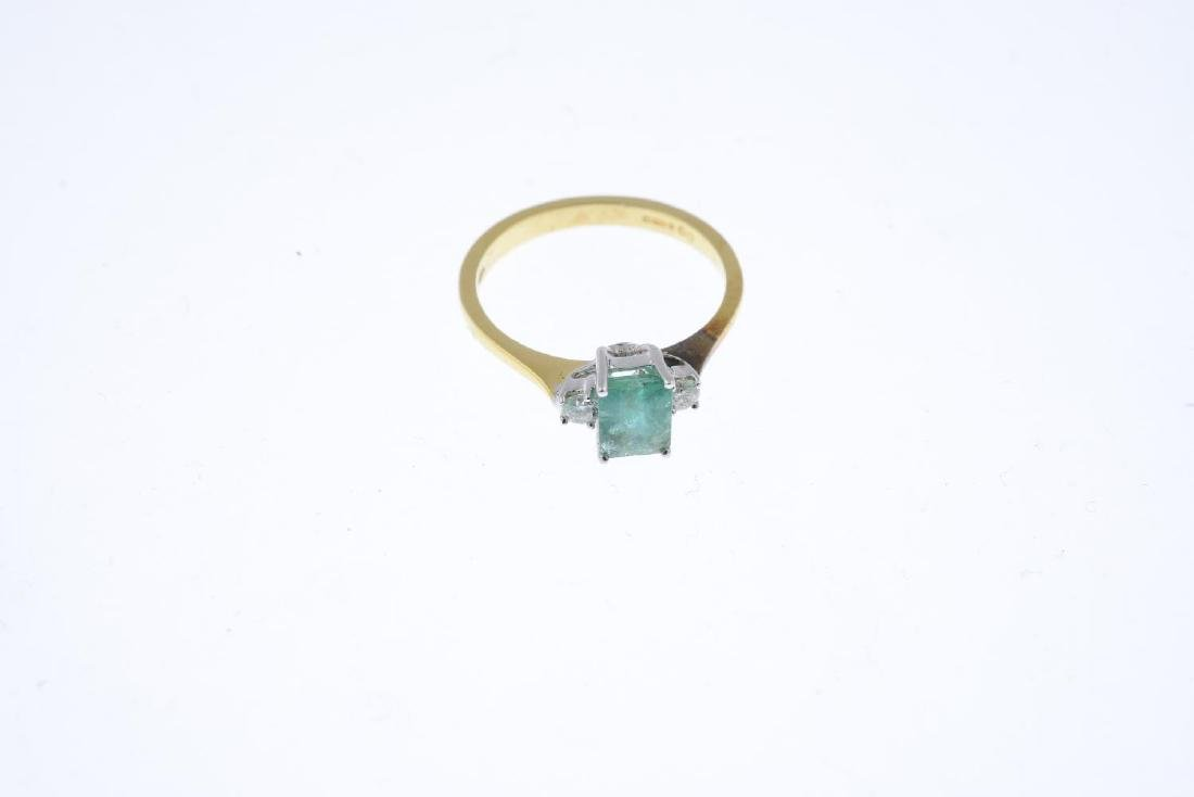 An 18ct gold emerald and diamond three-stone ring. The - 3