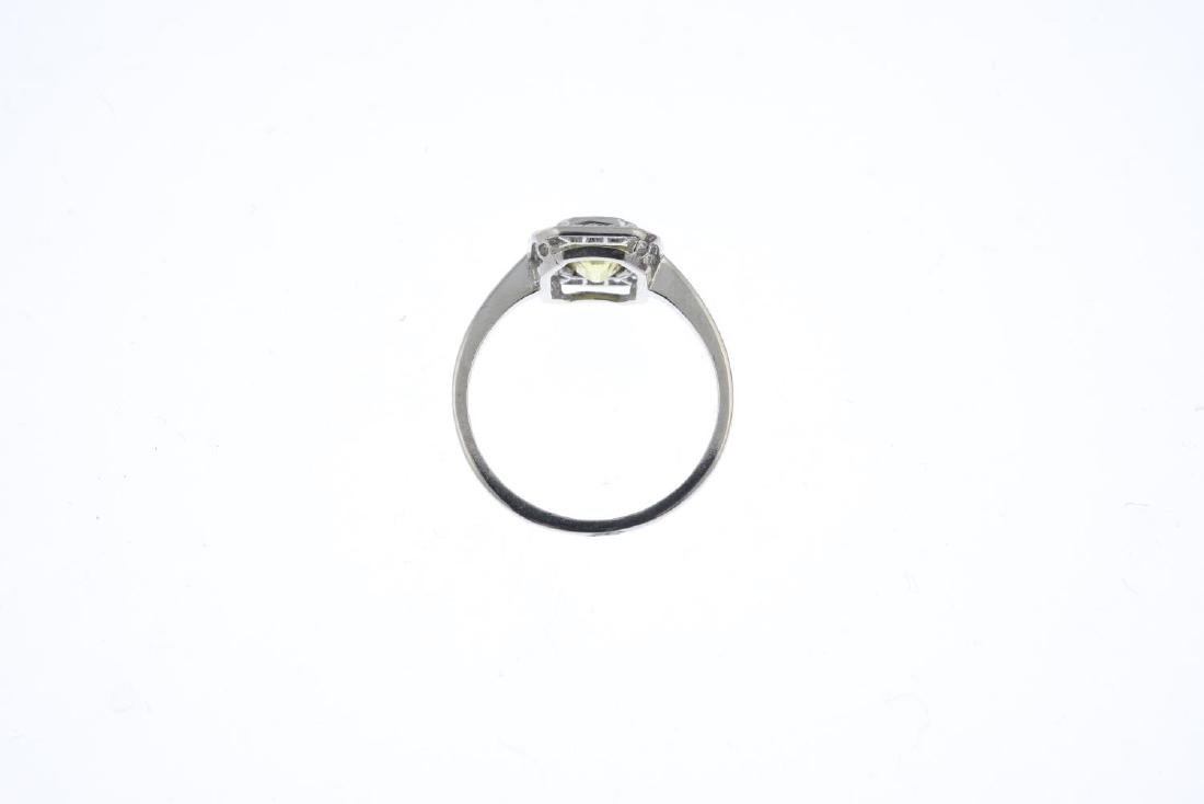 A sapphire and diamond cluster ring. The - 2
