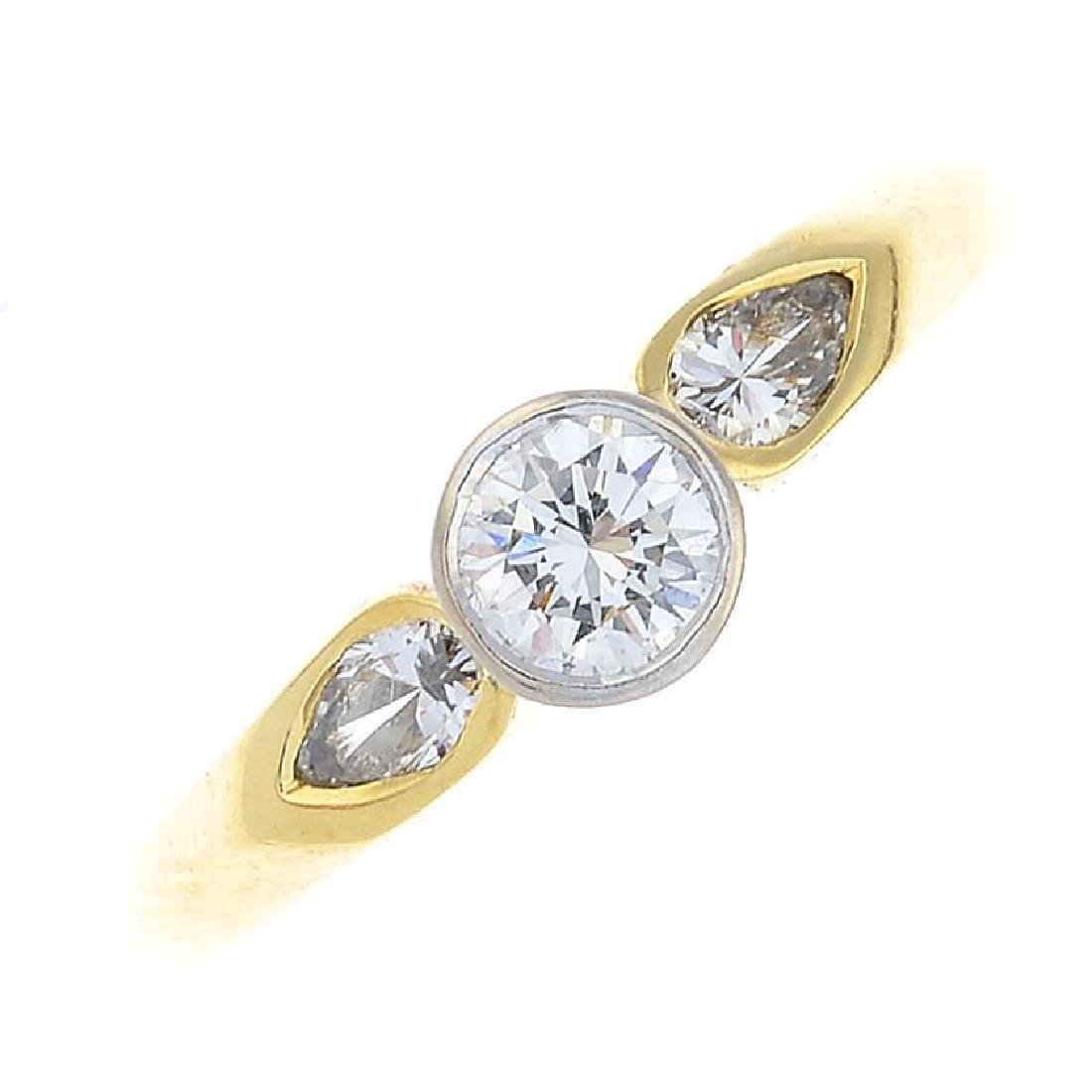 An 18ct gold diamond three-stone ring. The