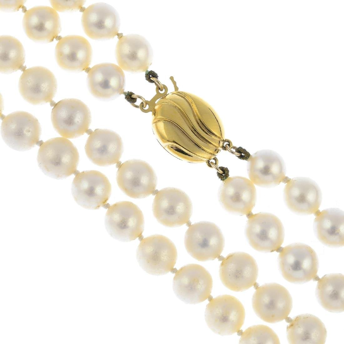 A cultured pearl two-row necklace. Comprising two