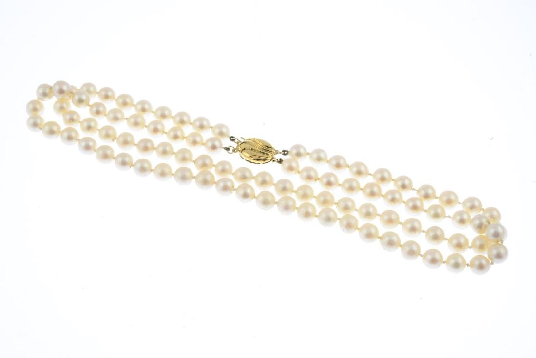 A cultured pearl two-row necklace. Comprising two - 2