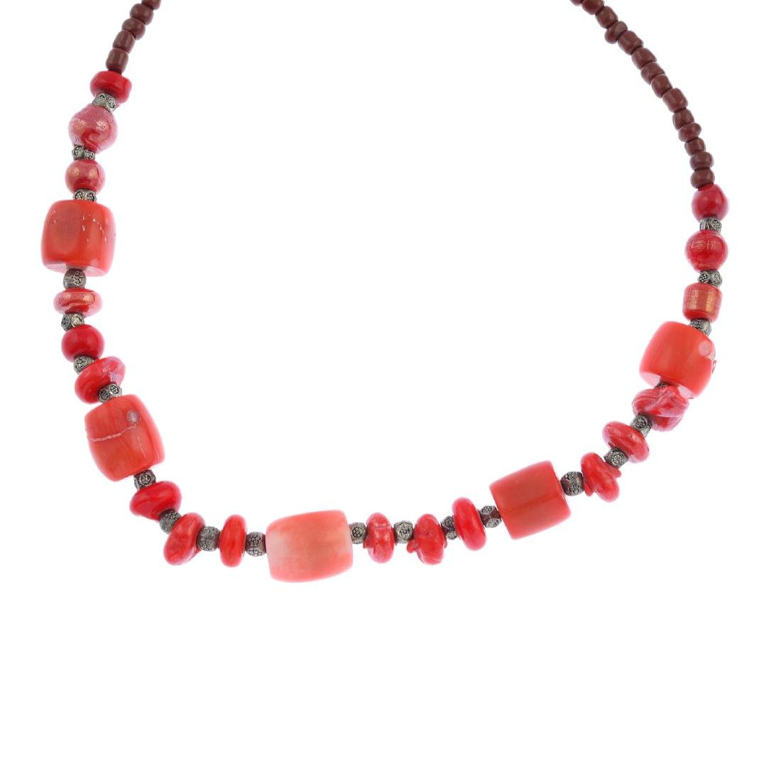 Eight assorted coral and glass necklaces and thirteen