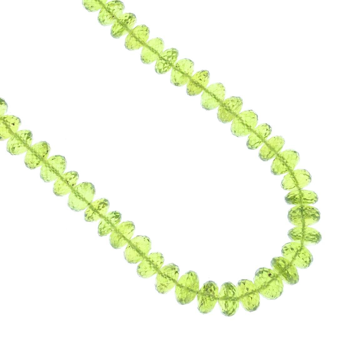 A peridot necklace. Designed as a single-row of faceted