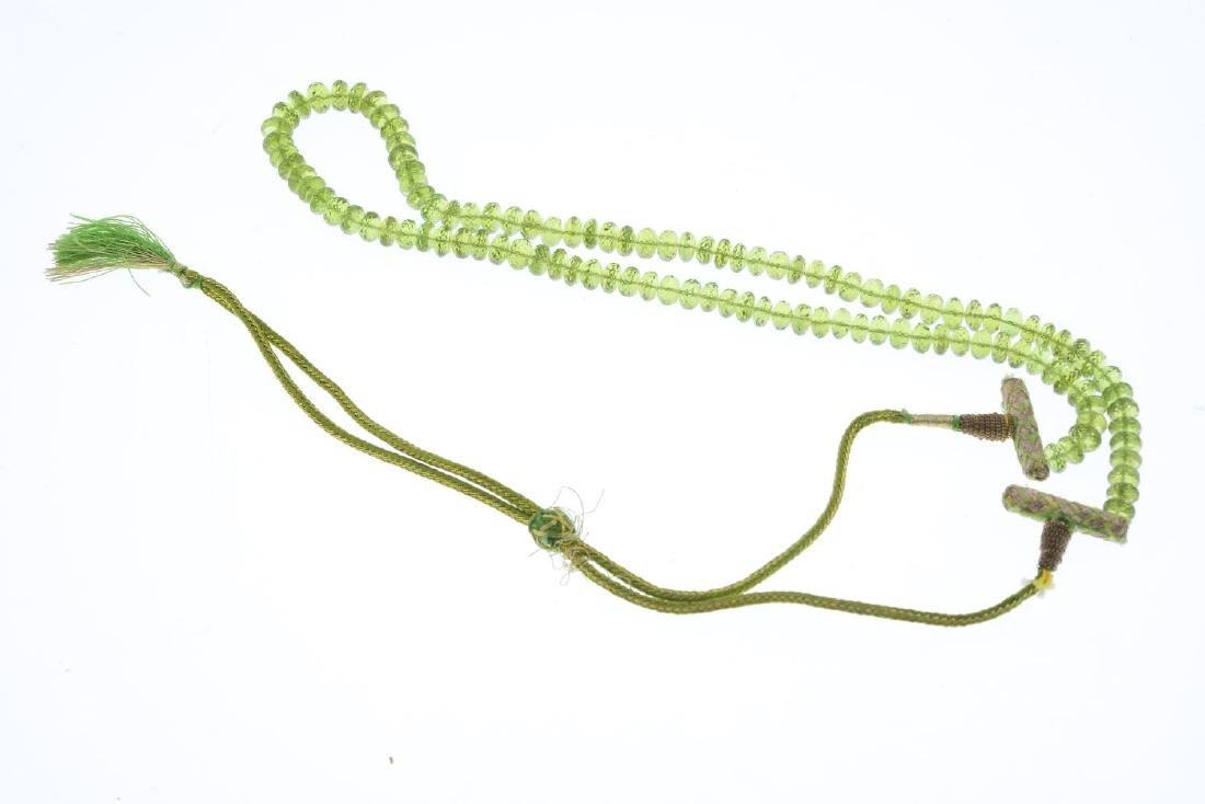 A peridot necklace. Designed as a single-row of faceted - 2