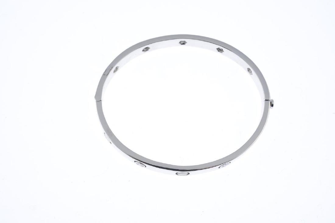 A diamond hinged bangle. Designed as an alternating - 2