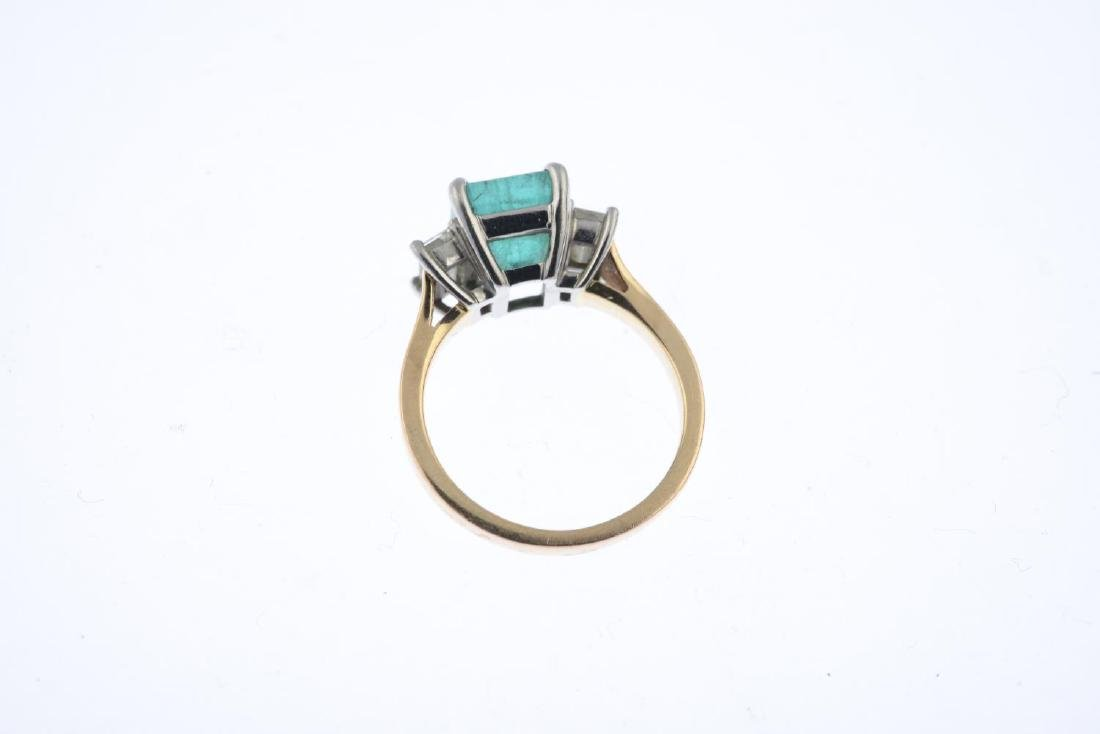An 18ct gold emerald and diamond three-stone ring. - 2