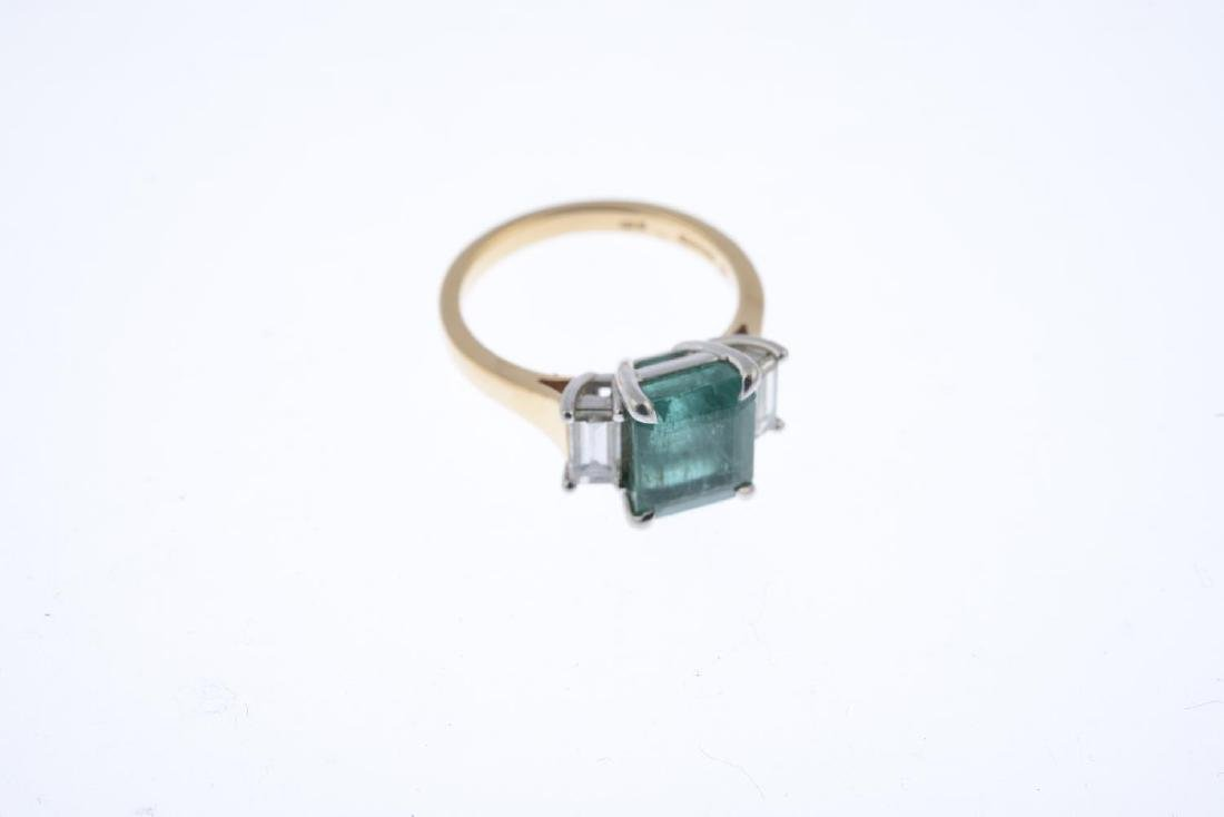 An 18ct gold emerald and diamond three-stone ring. - 3