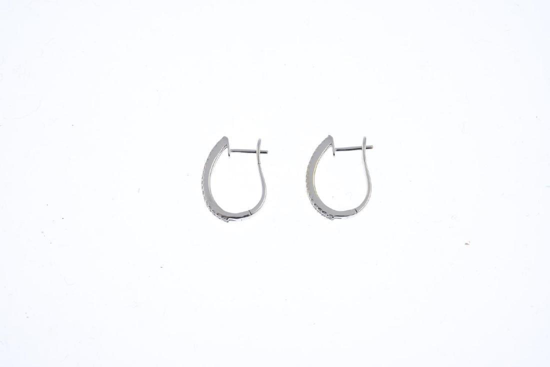 A pair of diamond hoop earrings. Each designed as a - 2