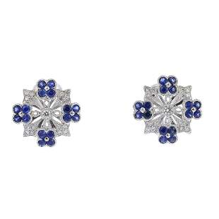 A pair of sapphire and diamond floral earrings Each of
