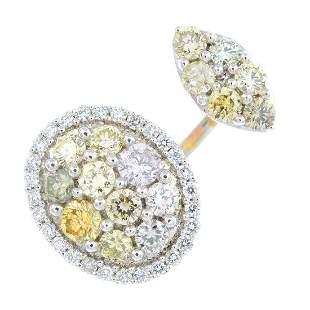 An 18ct gold coloured diamond and diamond dress ring