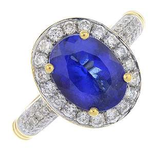 A tanzanite and diamond cluster ring The ovalshape