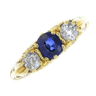 An 18ct gold sapphire and diamond threestone ring The