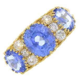 A sapphire threestone and diamond ring The graduated