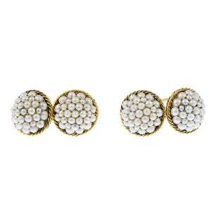 A pair of split pearl cufflinks Each designed as a