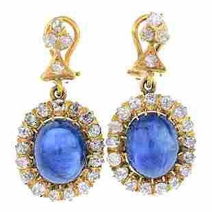 A pair of sapphire and diamond earrings Each designed