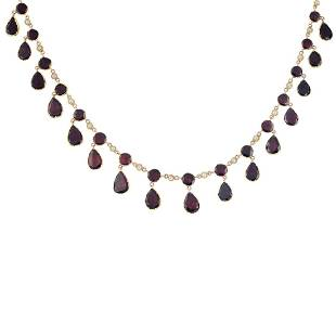 A gold foilback garnet and split pearl necklace