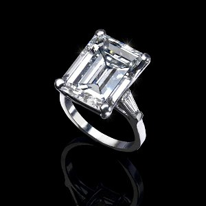 A large diamond single-stone ring. The emerald-cut