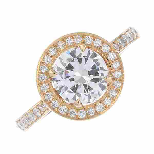 A Very Light Pink diamond and diamond cluster ring. The
