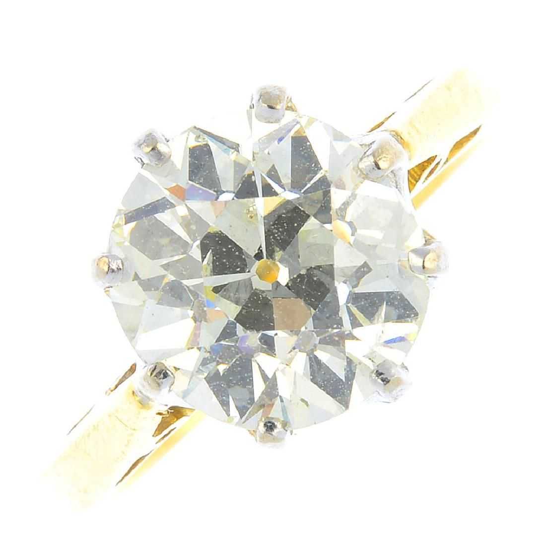 An 18ct gold diamond single-stone ring. The old-cut