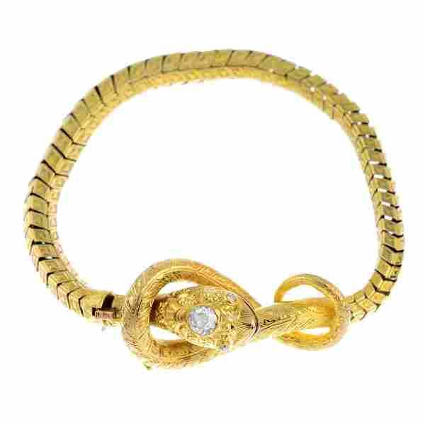 A mid Victorian gold diamond snake bracelet. The
