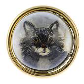 A reverse-carved intaglio cat brooch. The circular rock