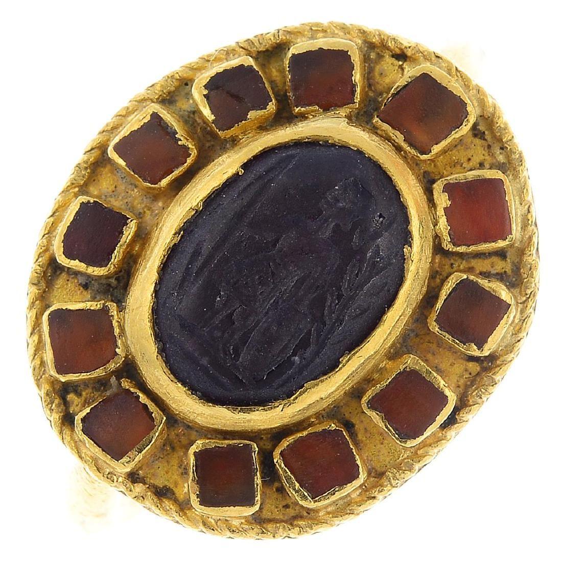 A hardstone ring. The oval hardstone cabochon intaglio,