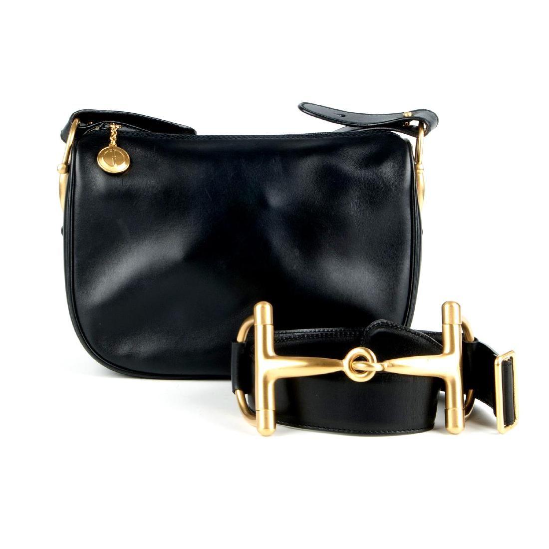 GUCCI - a black horsebit bag with matching belt.