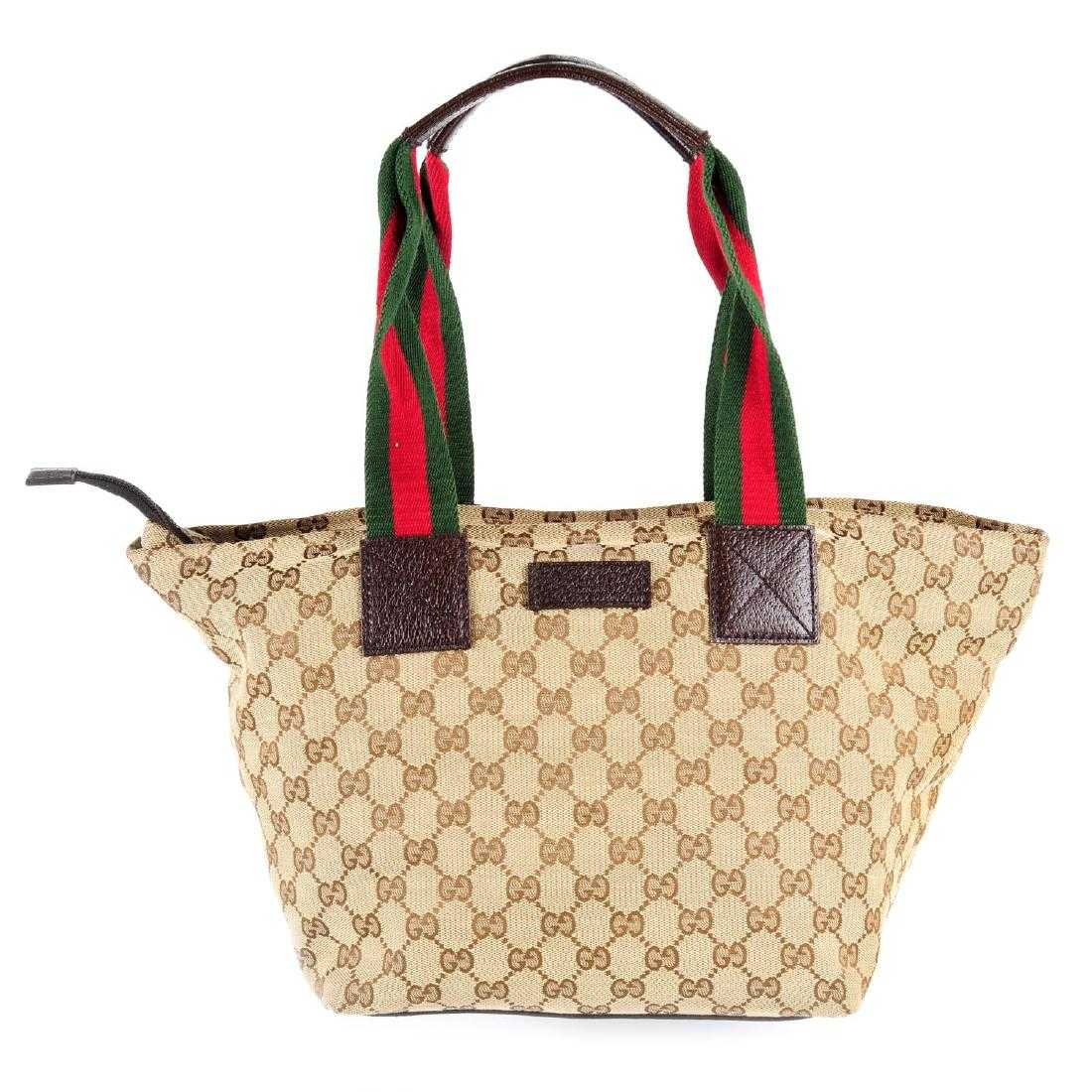 1fb2618b195 GUCCI - a Monogram Web handbag. Crafted from maker s