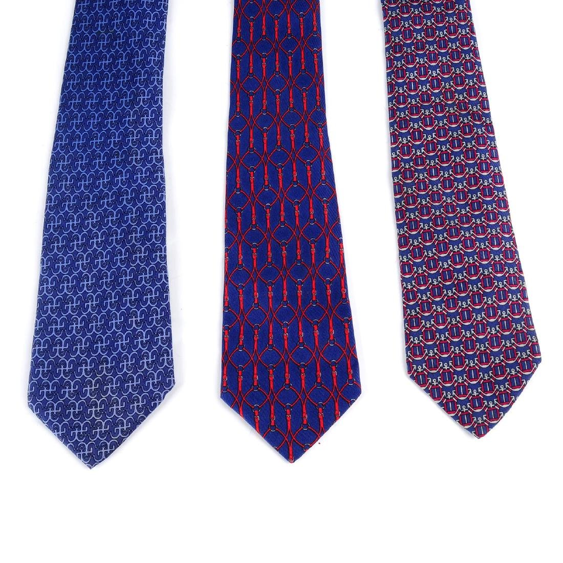 HERMÈS - three silk ties. All featuring blue and red