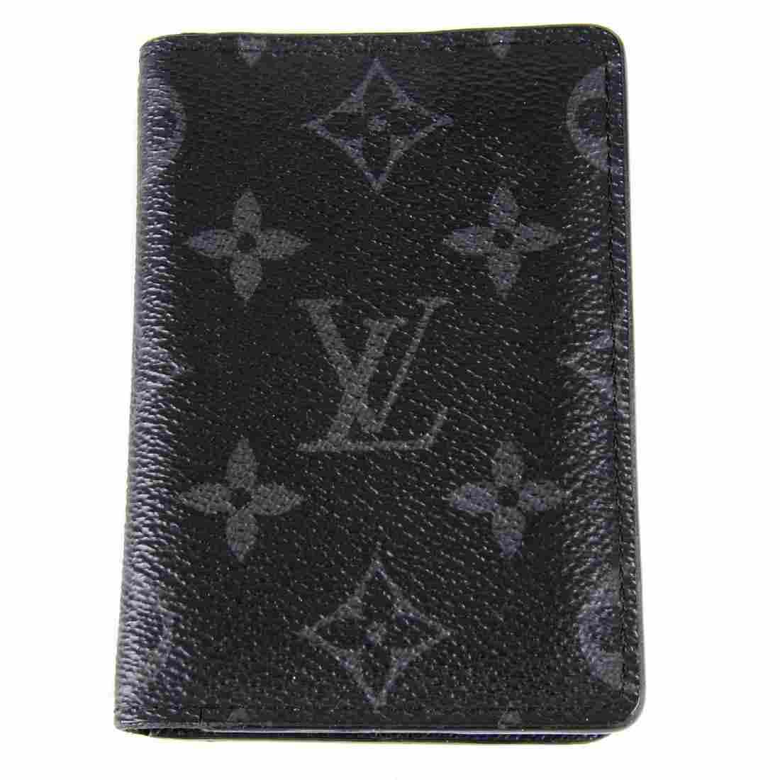 LOUIS VUITTON - a Monogram Eclipse cardholder wallet.