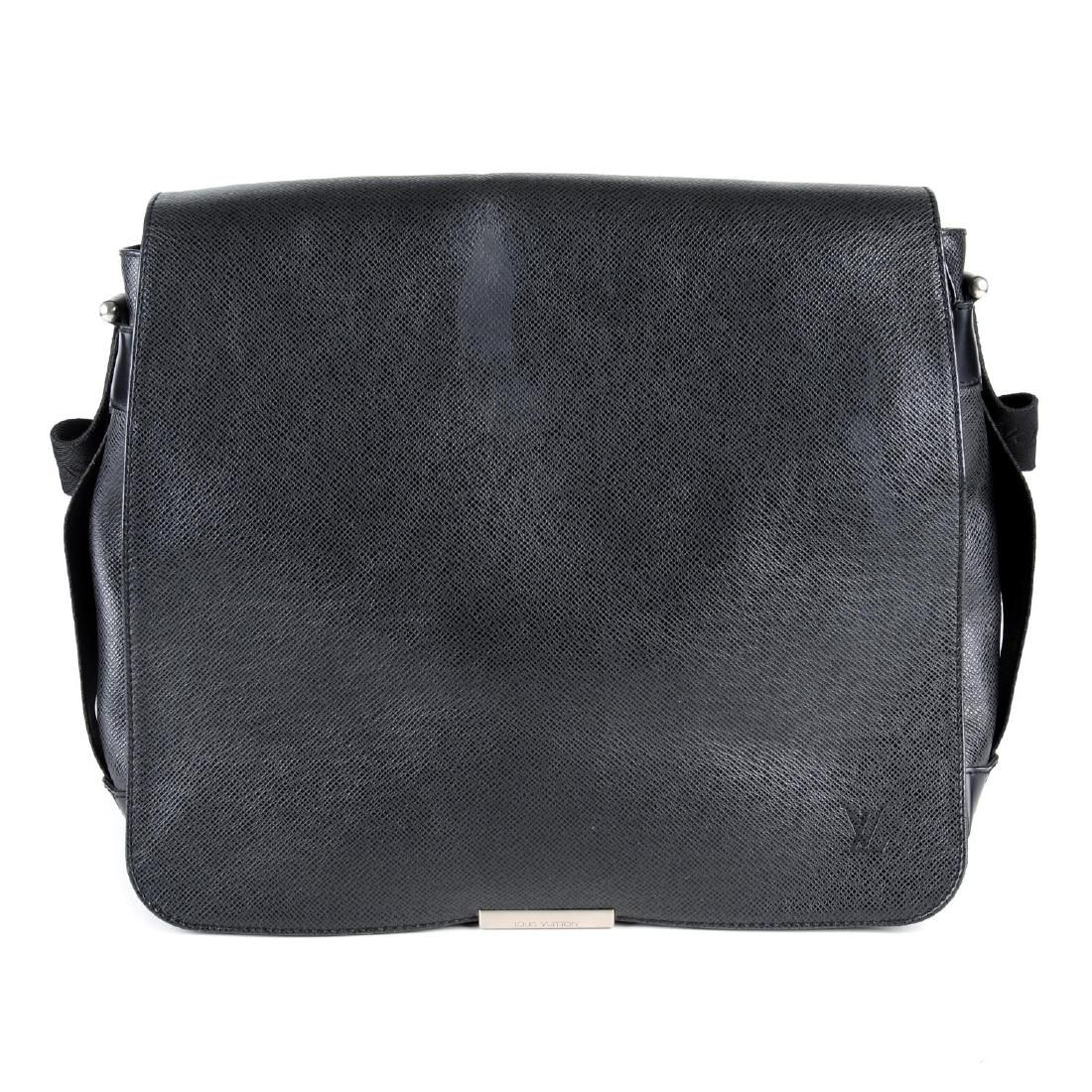 LOUIS VUITTON - a Taiga Viktor messenger bag. Crafted