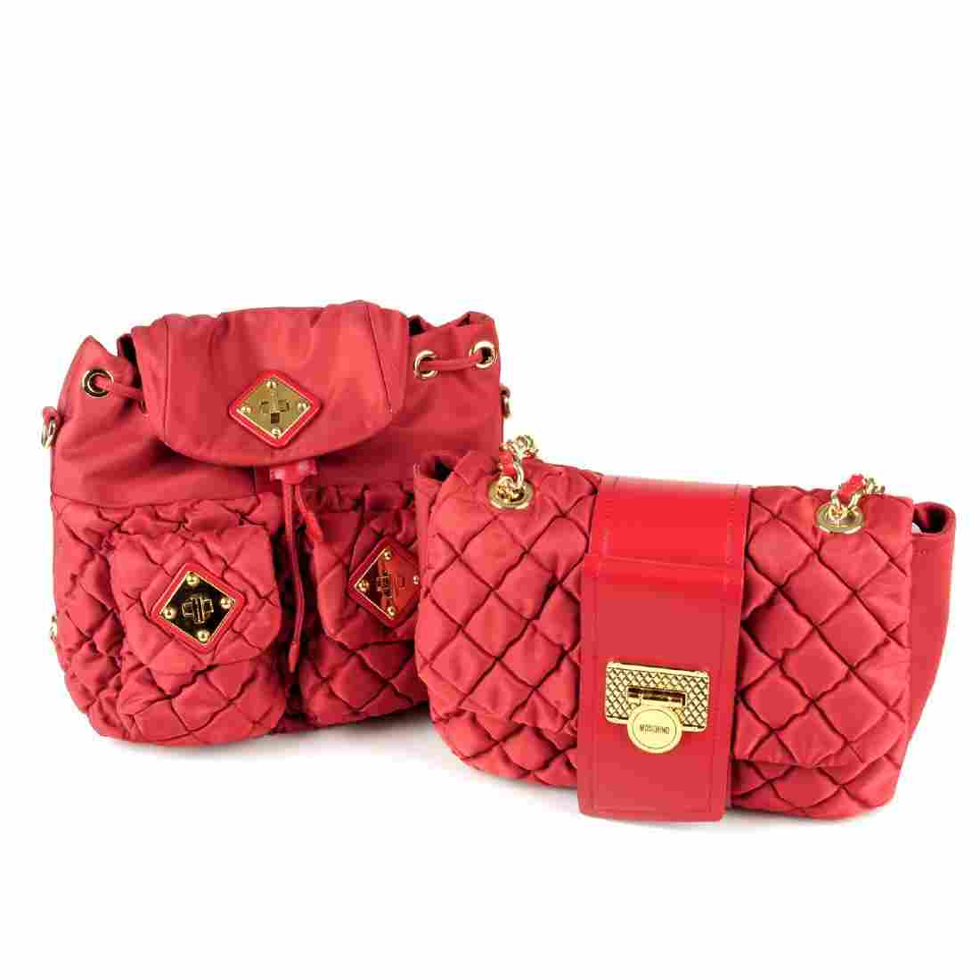 MOSCHINO - two red nylon handbags. To include a red