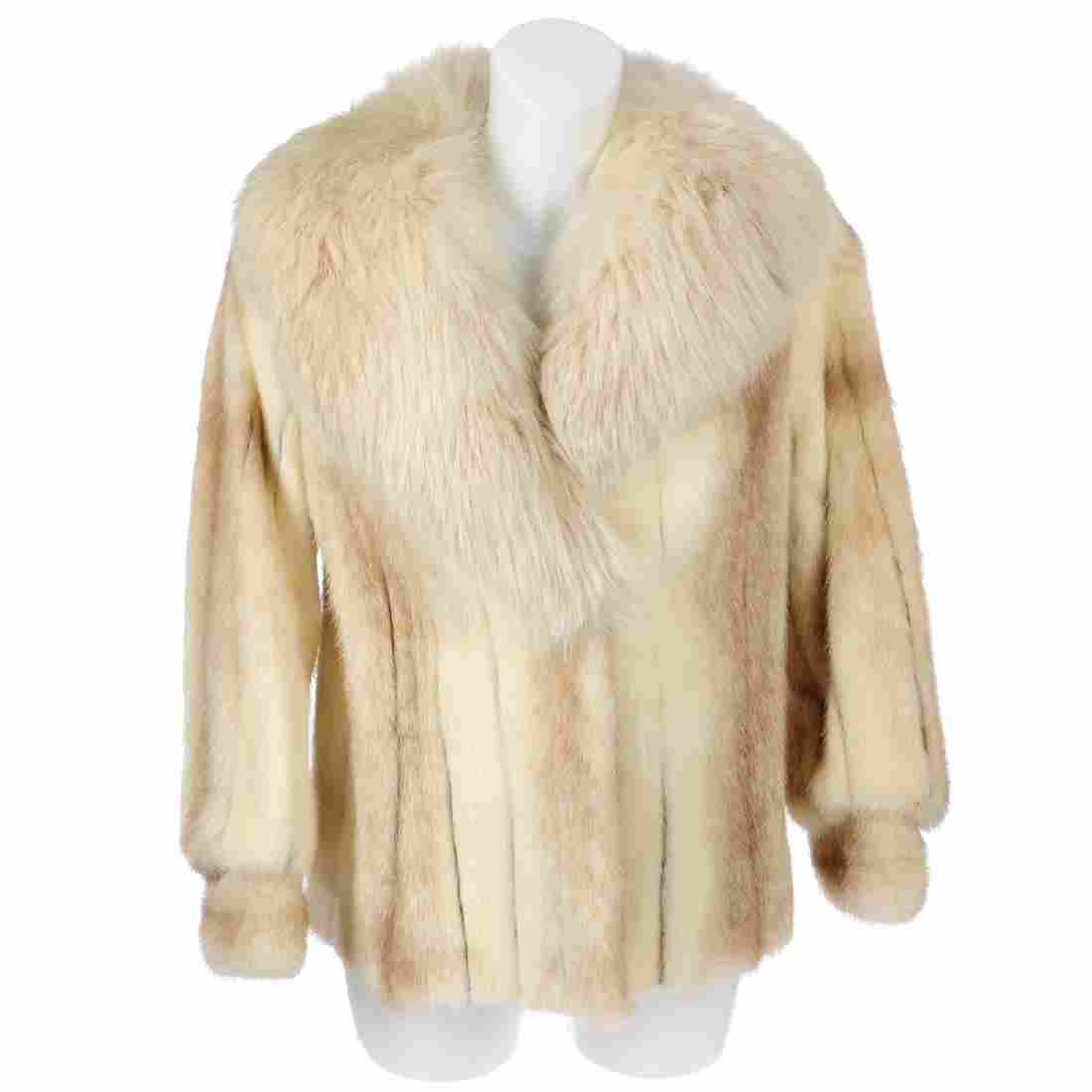 A two-tone mink jacket with fox fur collar. Crafted