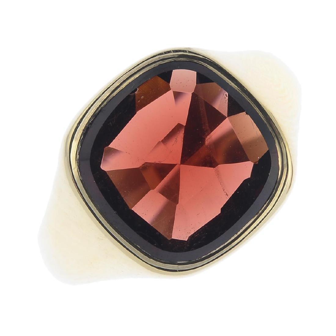A 9ct gold garnet signet ring. The cushion-shape