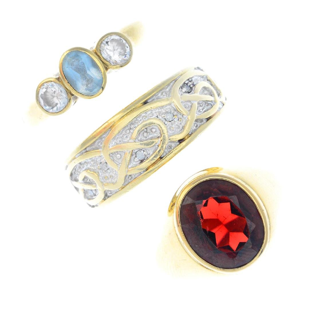 Seven gem-set rings. To include a 9ct gold garnet