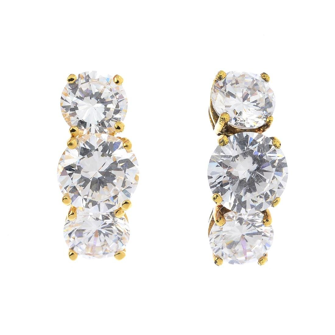 A pair of cubic zirconia earrings. Each designed as a